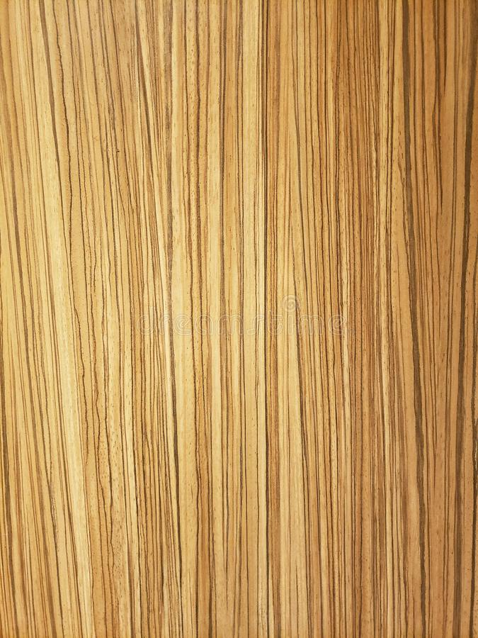 Tan and brown stylized wood grain board background stock photo
