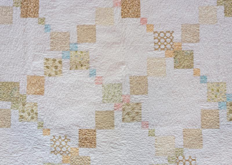 Tan and Neutral Quilt Squares. On cream background royalty free stock images