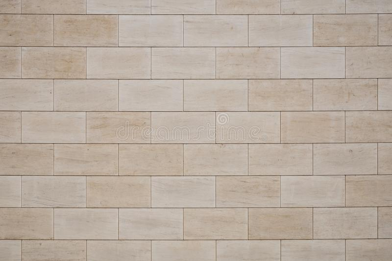 Tan wall tiles background texture royalty free stock image