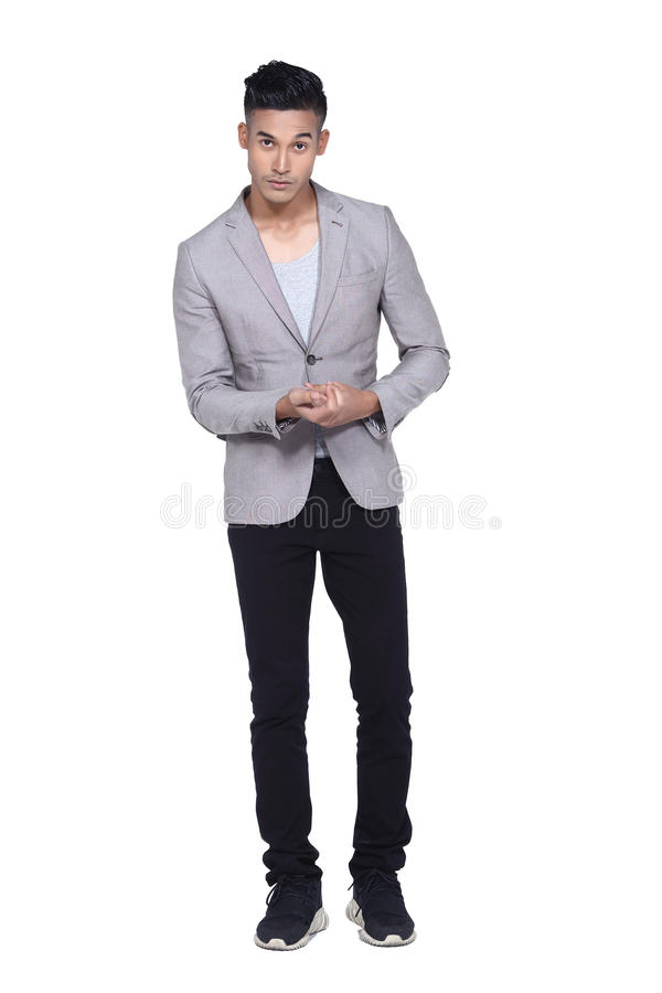 Tan Skin Asian black hair, handsom muscle good looking man in gr. Full length Tan Skin Asian black hair, handsom muscle good looking man in gray vest black pant royalty free stock image