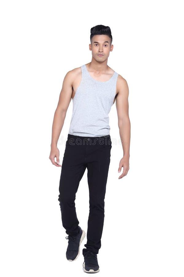 Tan Skin Asian black hair, handsom muscle good looking man in gr. Full length Tan Skin Asian black hair, handsom muscle good looking man in gray vest black pant stock image