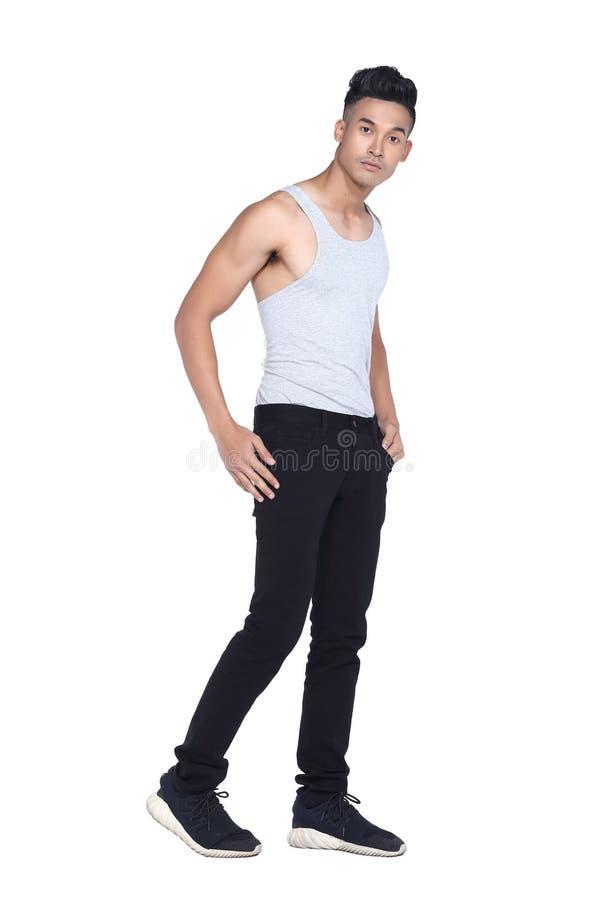 Tan Skin Asian black hair, handsom muscle good looking man in gr. Full length Tan Skin Asian black hair, handsom muscle good looking man in gray vest black pant stock photos