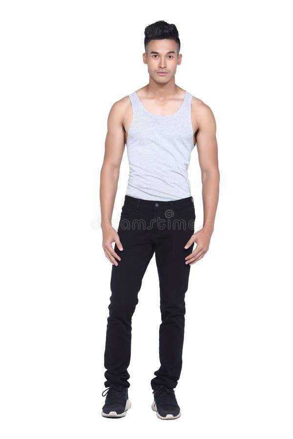 Tan Skin Asian black hair, handsom muscle good looking man in gr. Full length Tan Skin Asian black hair, handsom muscle good looking man in gray vest black pant royalty free stock images