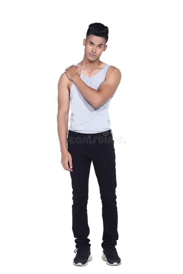 Tan Skin Asian black hair, handsom muscle good looking man in gr. Full length Tan Skin Asian black hair, handsom muscle good looking man in gray vest black pant royalty free stock photos