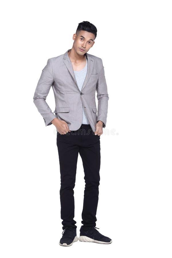 Tan Skin Asian black hair, handsom muscle good looking man in gr. Full length Tan Skin Asian black hair, handsom muscle good looking man in gray vest black pant stock photography
