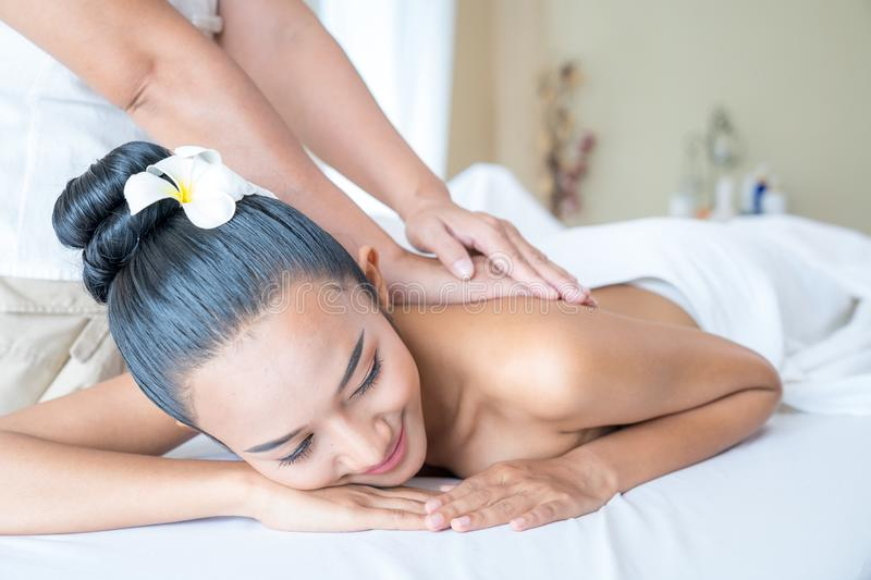 Tan skin woman in the spa massage therapy,. Relaxing with aroma stock photography