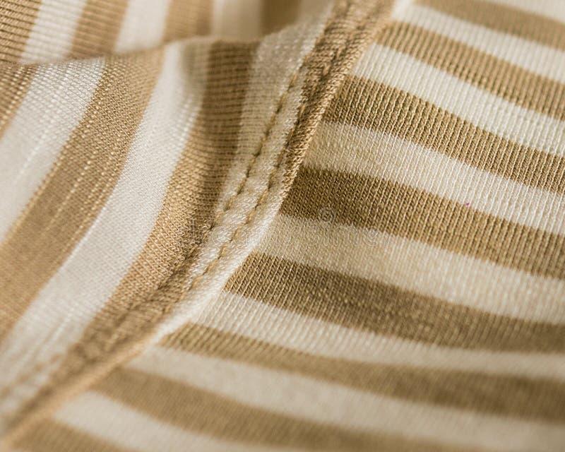 Tan und Elfenbein-gestreiftes weiches Gewebe stockbild
