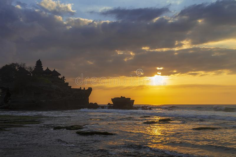 Tanah Lot in golden sunset, Bali, Indonesia royalty free stock photos