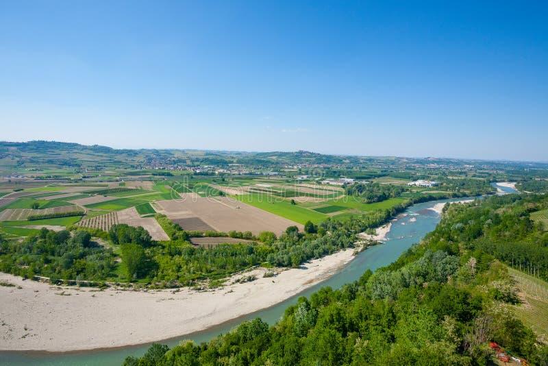Tanaro river view from Langhe, Italy. Tanaro river view. Vineyards from Langhe region,Italy agriculture. Unesco world heritage site royalty free stock photo