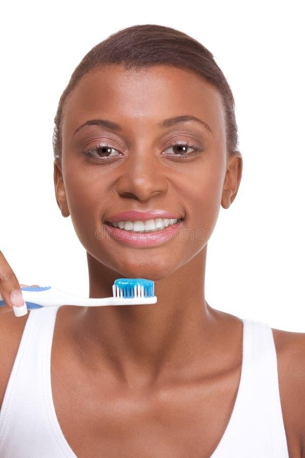 Tand hygiëne Afro-Amerikaans meisje met tandenborstel stock afbeelding