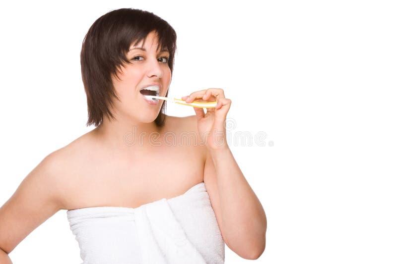 tandborstekvinna royaltyfri bild