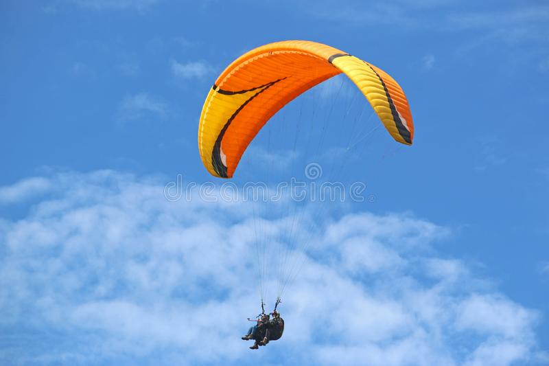 Tandem Paraglider in a blue sky stock image