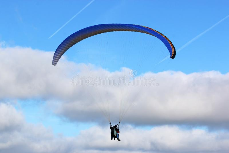 Tandem Paraglider in a blue sky royalty free stock images