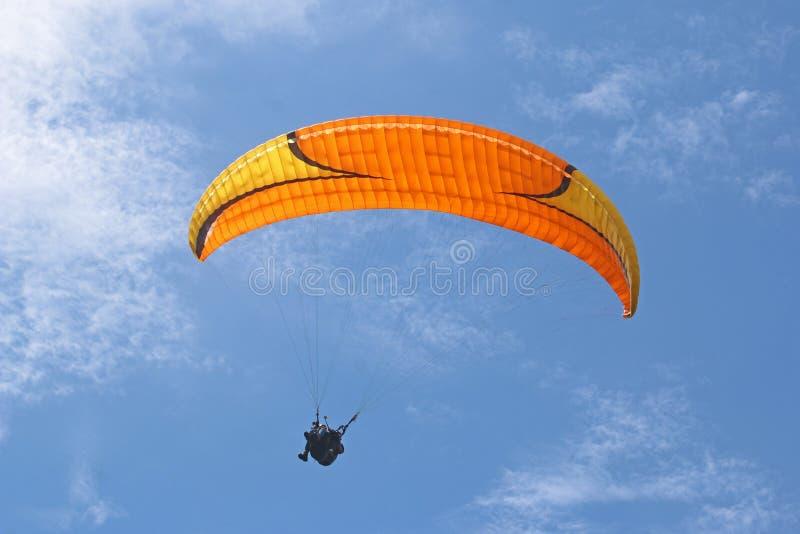 Tandem paraglider in a blue sky stock images