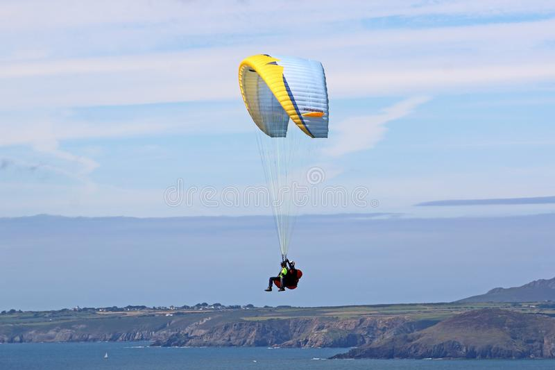 Tandem paraglider lflying at Newgale, Wales royalty free stock images