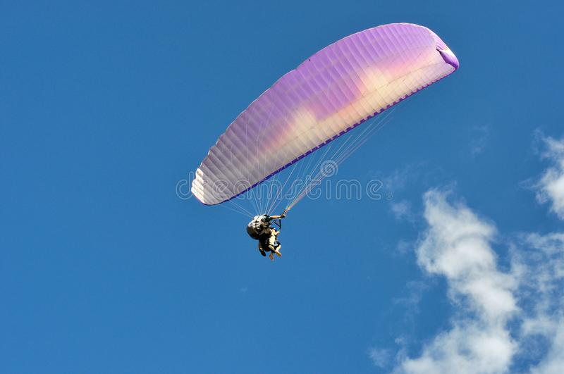 Tandem paraglider flying stock photography