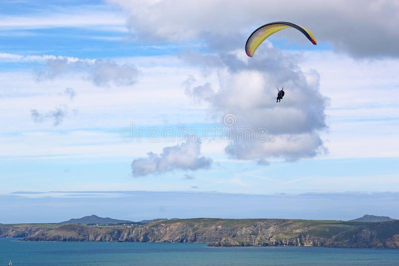 Tandem paraglider flying at Newgale stock image