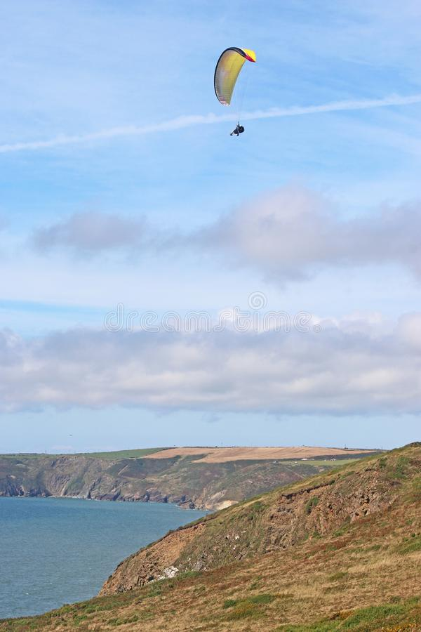Tandem paraglider flying at Newgale stock photo