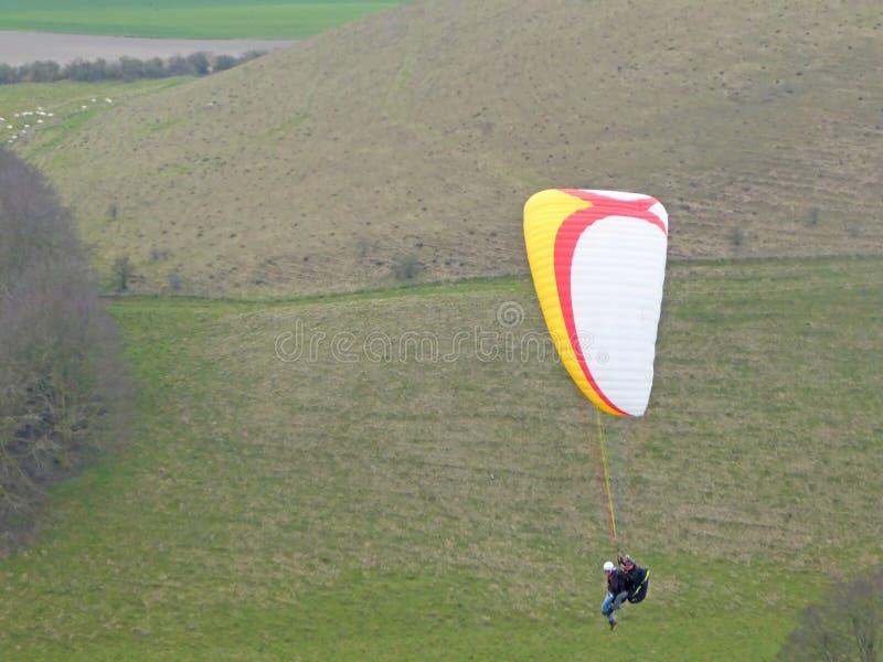 Tandem paraglider flying stock photo
