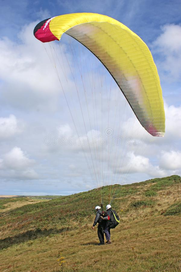 Tandem paraglider launching at Newgale, Wales royalty free stock photos