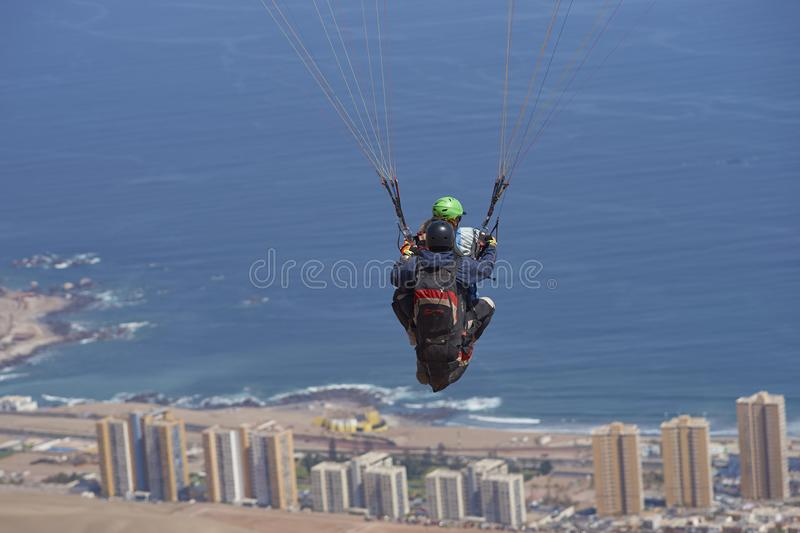 Tandem Paragliding over Iquique in northern Chile stock photos