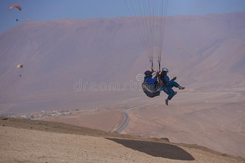Tandem Paragliding over Iquique in northern Chile stock image