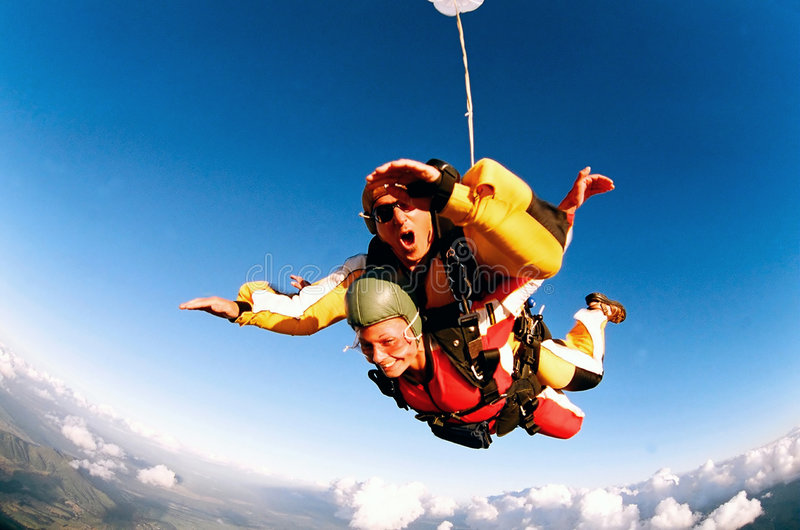 Tandem skydivers in action