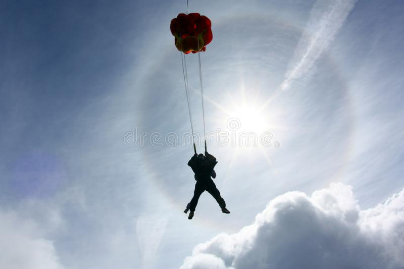 Tandem skydiving. A parachute is deploying. stock image