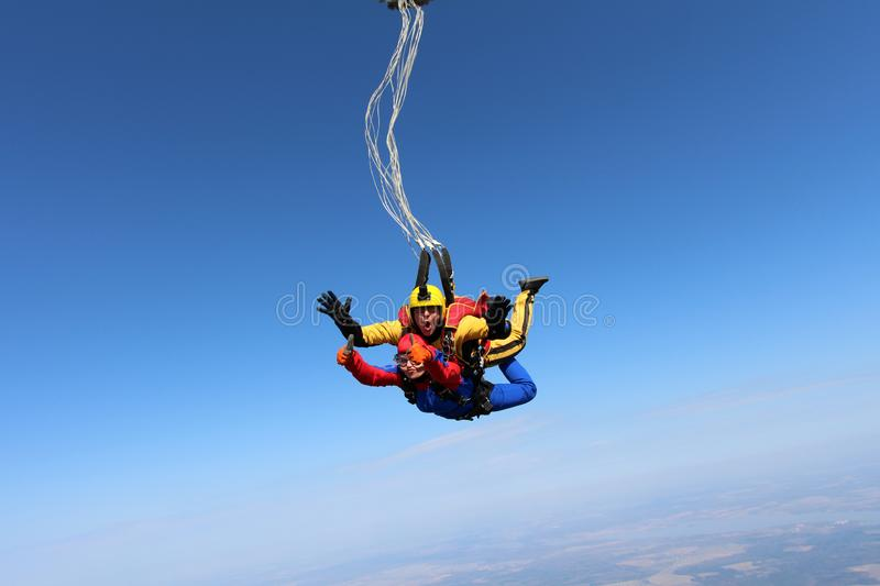 Tandem skydiving. A parachute is deploying. stock photo