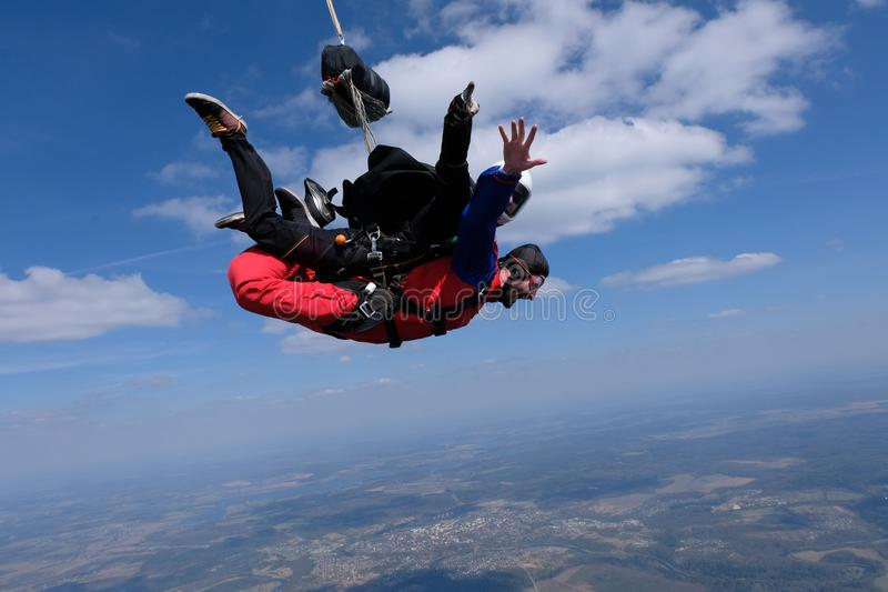 Tandem skydiving. Two happy men are in the sky. royalty free stock image