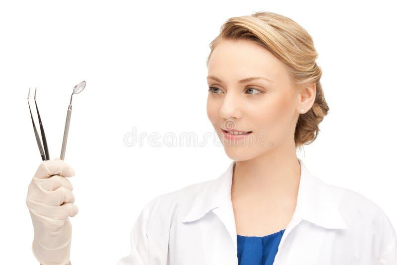 tandläkarehjälpmedel royaltyfri fotografi