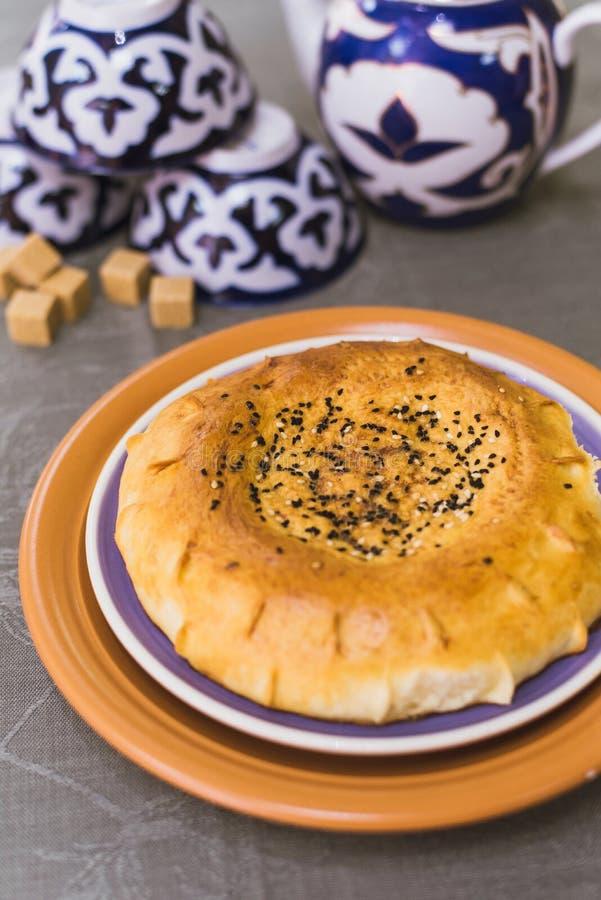 Tandoor tortilla lies on the eastern dishes. Eastern tea stock image