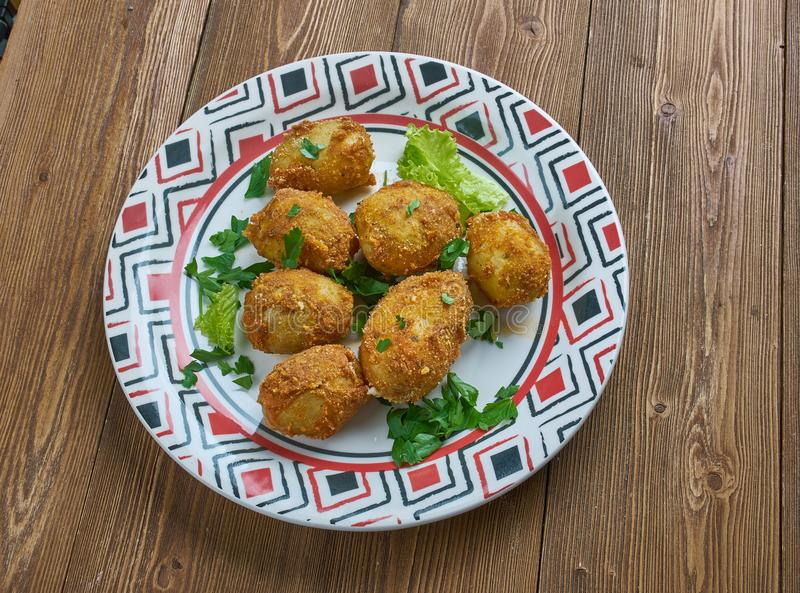 Tandoori aloo tikka. Spiced marinated potatoes which are either grilled or pan frie.Indian cuisine royalty free stock images