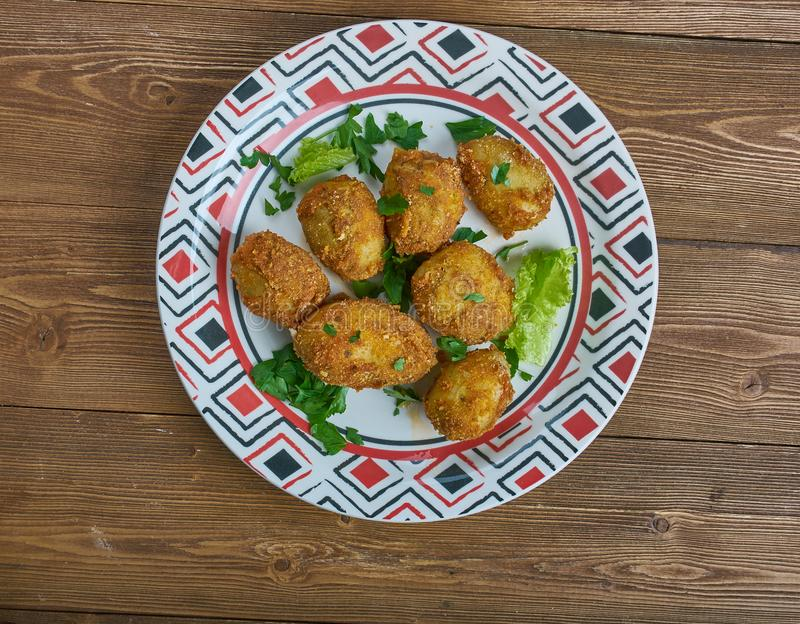 Tandoori aloo tikka. Spiced marinated potatoes which are either grilled or pan frie.Indian cuisine royalty free stock photos