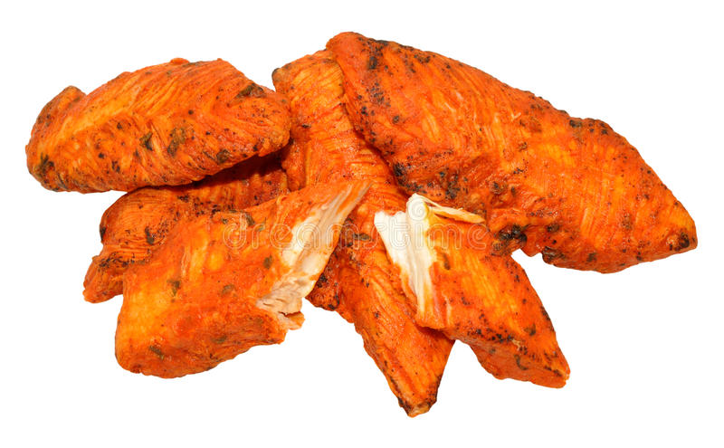 Tandoori Chicken Fillets. Cooked spicy tandoori chicken fillets isolated on a white background stock photography