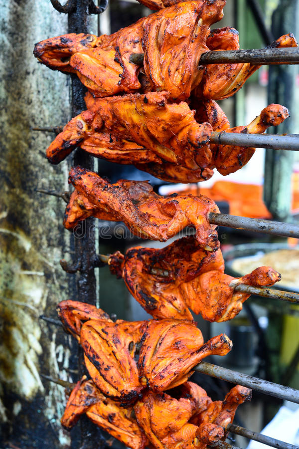 Tandoori Chicken on a grill stock images