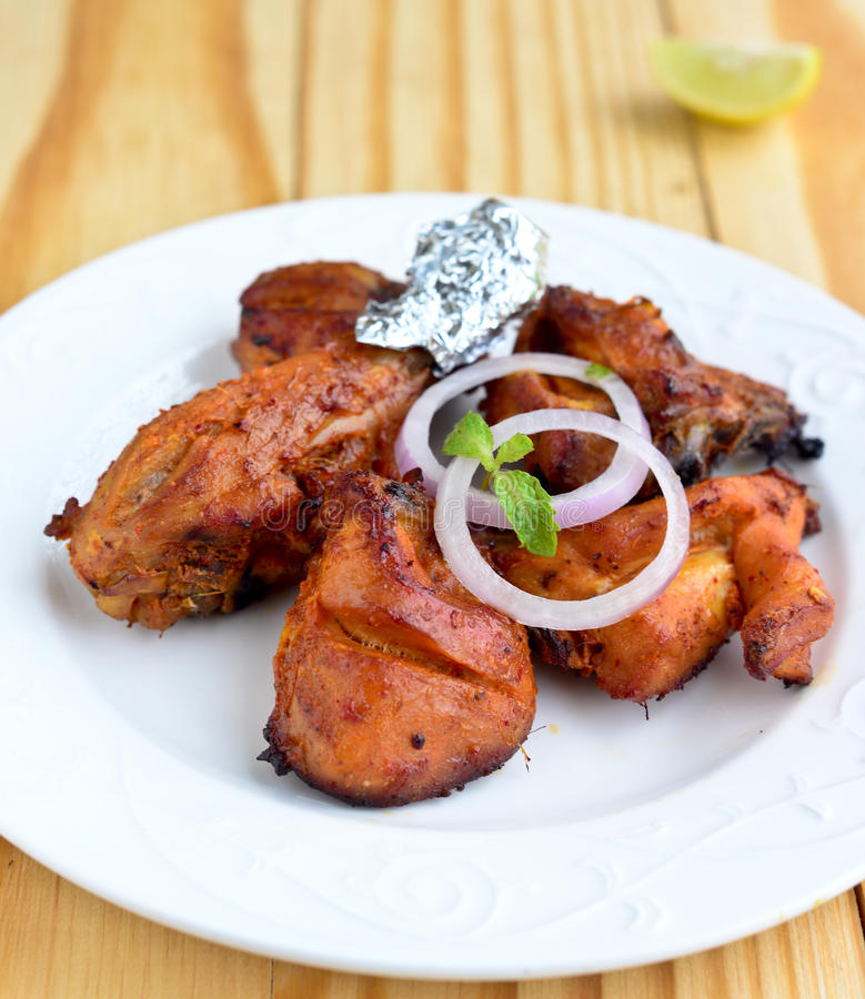 Tandoori Chicken. Chicken Tandoori is a highly popular Indian dish consisting of roasted chicken, yogurt, and spices stock photos