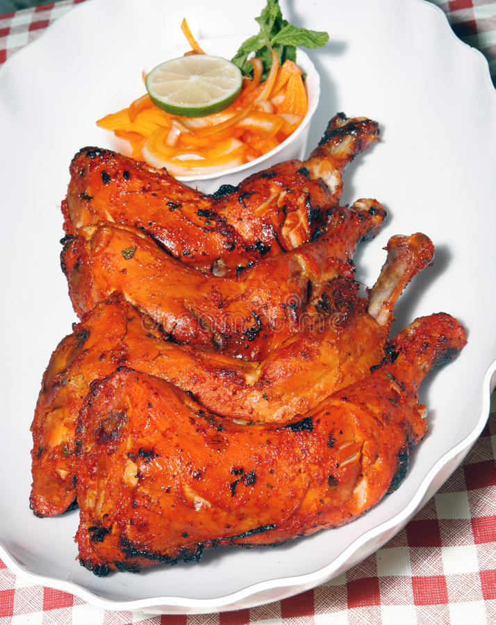 Tandoori chicken legs. In plate royalty free stock photography