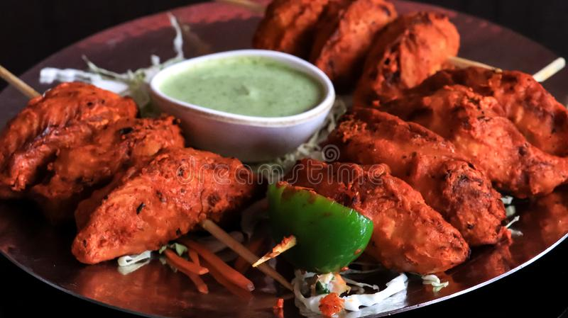 Tandoori chicken momo. Presented as stick food stock photography