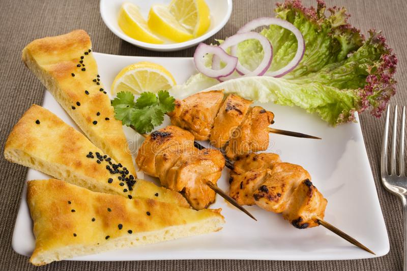 Tandoori Chicken with Naan Bread. And salad royalty free stock photography
