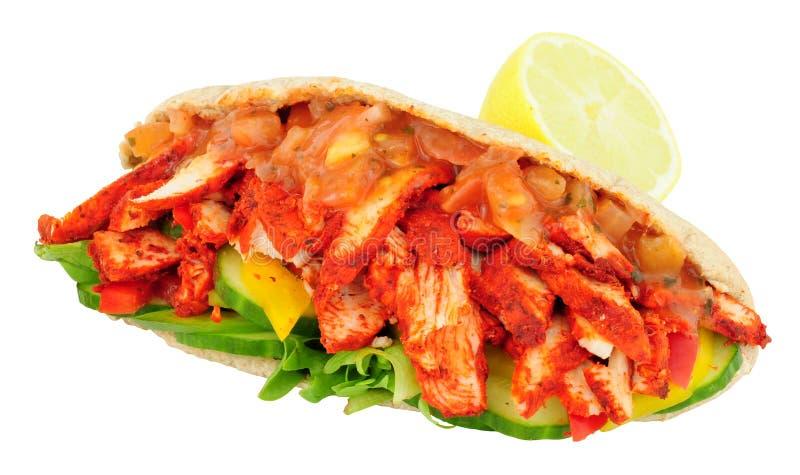 Tandoori Chicken Pitta Bread Sandwich. Tandoori chicken and salad pitta bread sandwich isolated on a white background stock photos