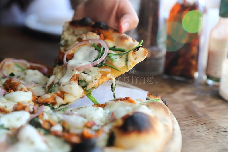Tandoori Chicken Pizza on wooden table. In close up stock photos