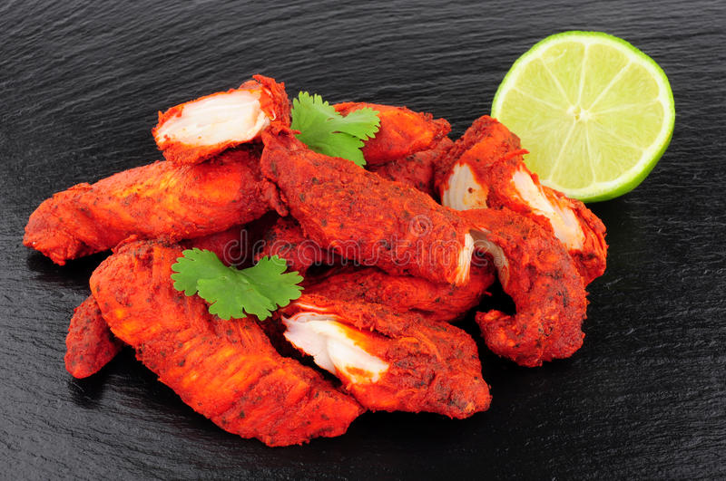 Tandoori Chicken On A Slate Background royalty free stock image