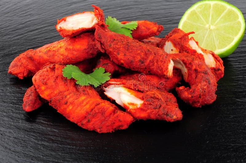 Tandoori Chicken On A Slate Background stock photo