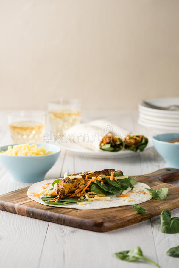 Tandoori chicken wrap with tzatziki royalty free stock images