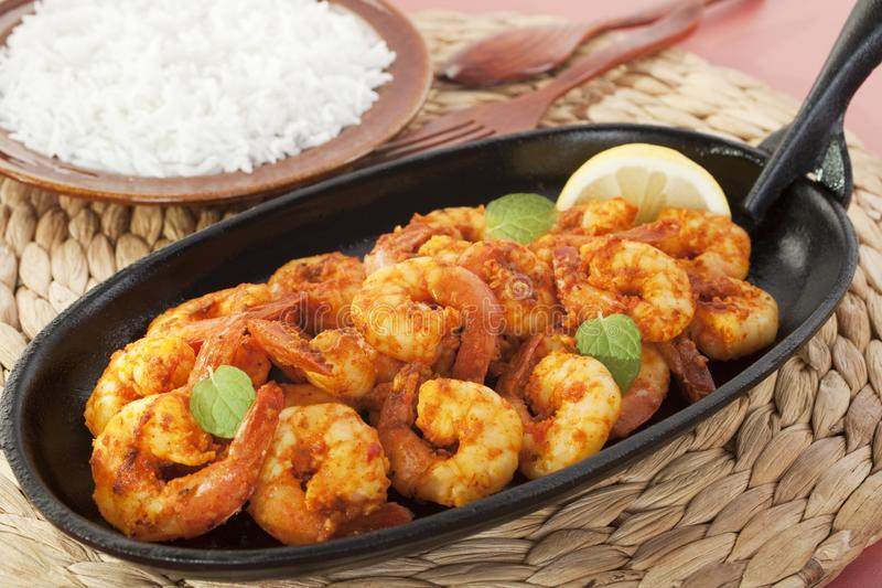 Tandoori Prawns Shrimp Indian Curry Food Meal. Tandoori prawns on a cast iron sizzle platter, served with basmati rice stock image