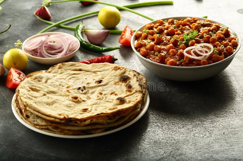Tandoori roti from Indian cuisine. Healthy vegan diet food- homemade roti served with chickpea curry channa masala royalty free stock photos