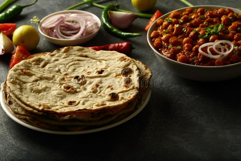 Tandoori roti from Indian cuisine. Healthy vegan diet food- homemade roti served with chickpea curry channa masala stock image