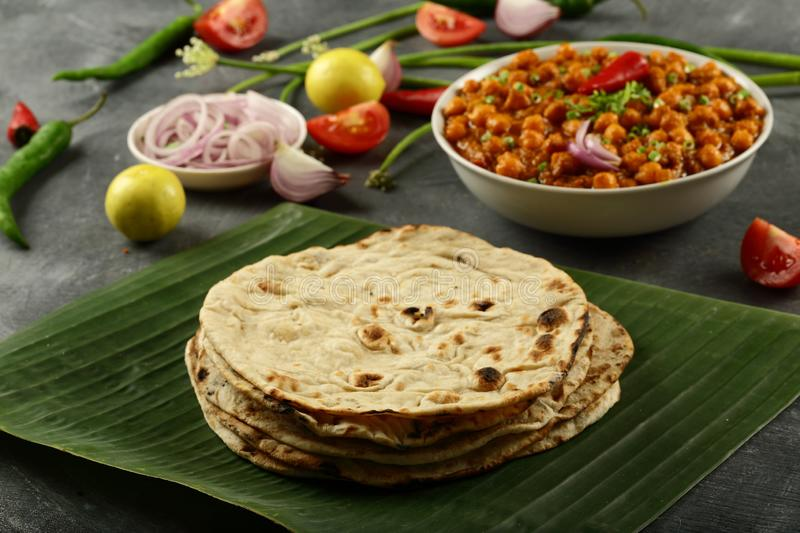 Tandoori roti from Indian cuisine.vegetarian meal. Healthy vegan diet food- homemade roti served with chickpea curry channa masala royalty free stock photos