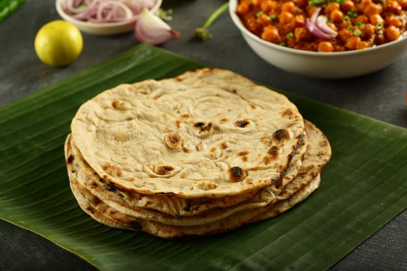 Tandoori roti from Indian cuisine.vegetarian meal. Healthy vegan diet food- homemade roti served with chickpea curry channa masala royalty free stock images